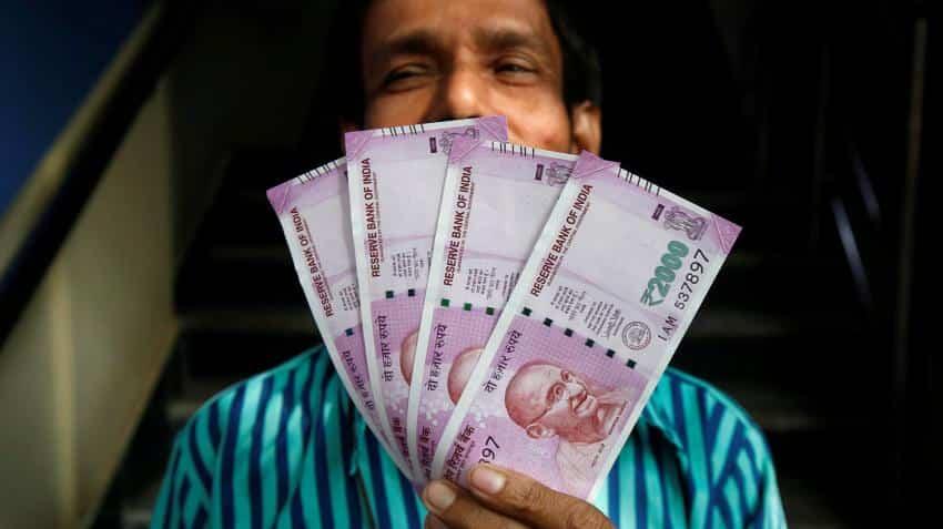 Money-changers make merry as people flock to convert black money