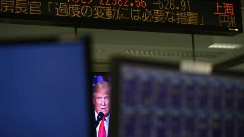 Asian markets hit by Trump fears, weak yen lifts Tokyo