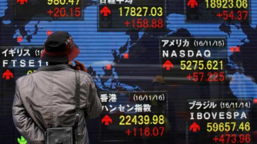 Dollar edges away from 13-year peak, Asian stocks slip