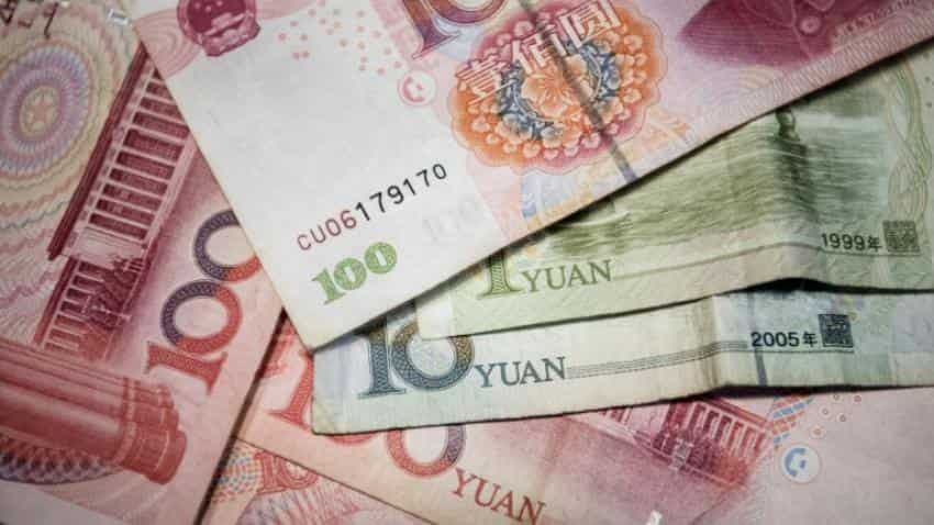 China weakens yuan-dollar rate below 6.9 mark
