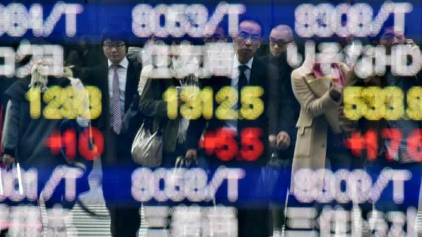 Oil prices fall further in Asia, yen gains hit Tokyo