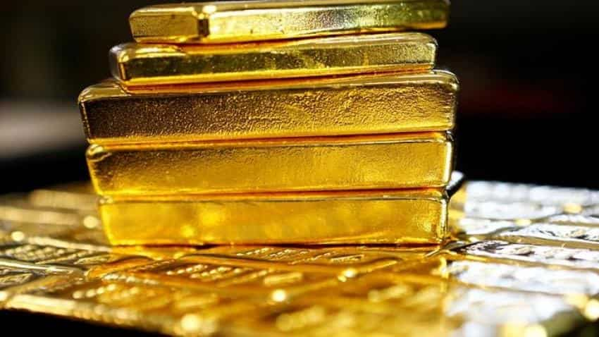 Gold prices ease, surrender gains on dollar strength