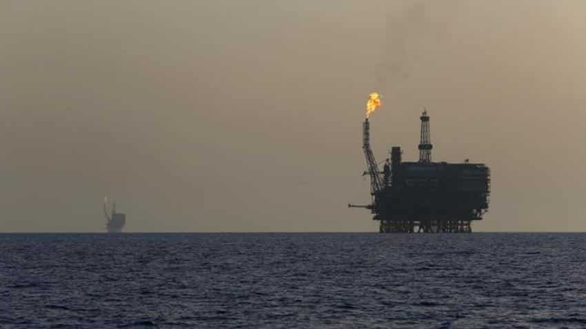 Oil prices rise on U.S. crude stock decline, weaker dollar