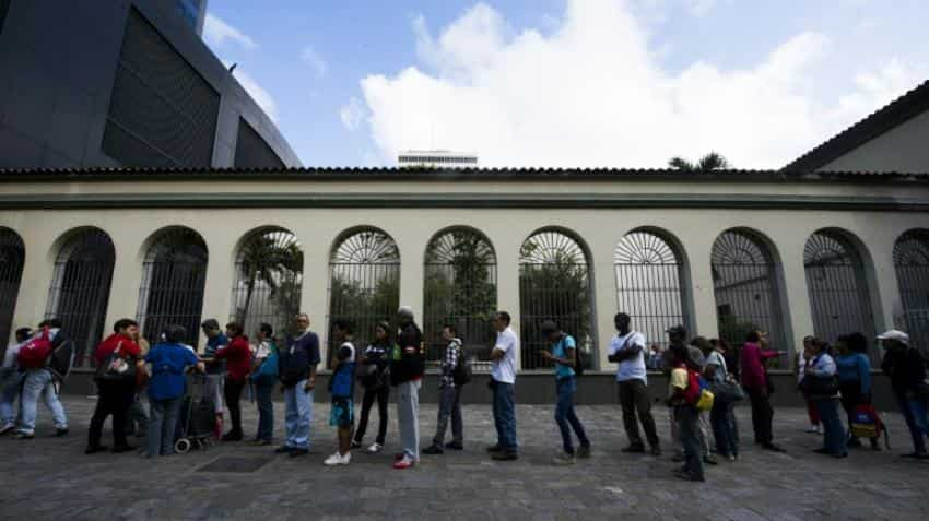 Cash chaos as Venezuela stuck in currency limbo