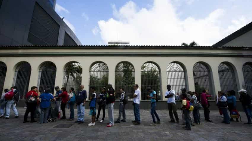 Cash chaos as Venezuela stuck in currency limbo