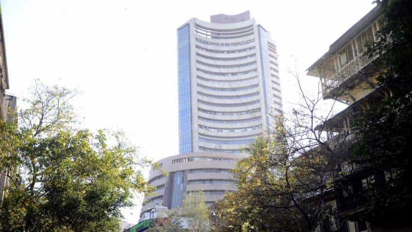 Sensex, Nifty open marginally in red in early trade