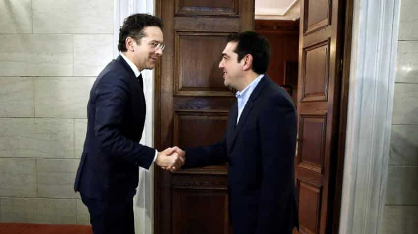 Eurozone clears way to resume debt relief for Greece