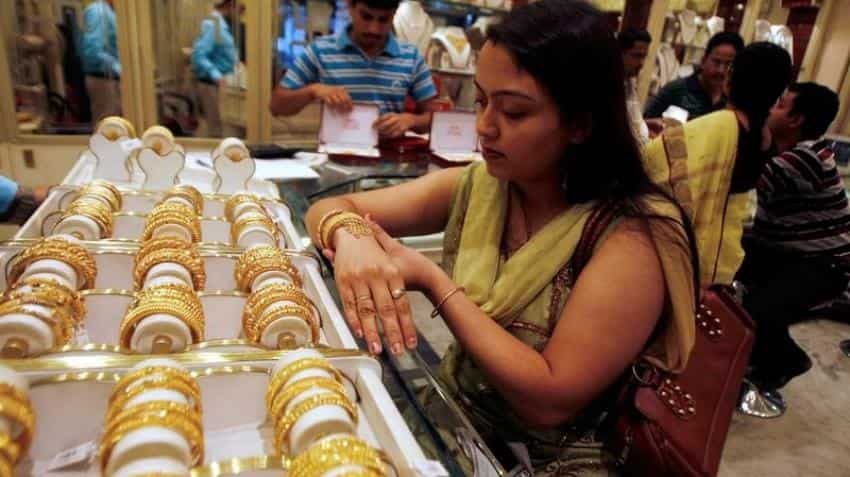 Gold futures up Rs 100 on global cues