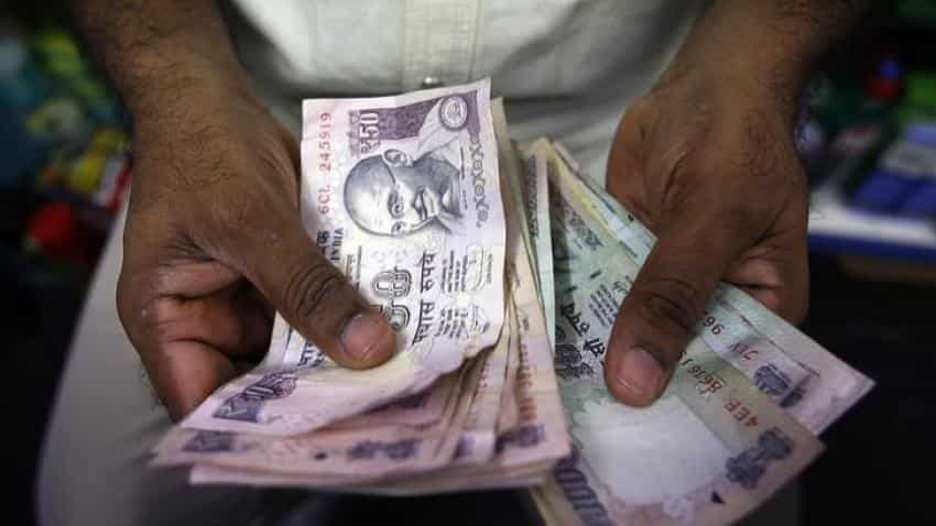 Rupee weakens by 15 paise against dollar in early trade