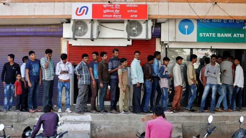 Indians line up at banks to deposit savings or see them disappear on last day of exchange on December 30