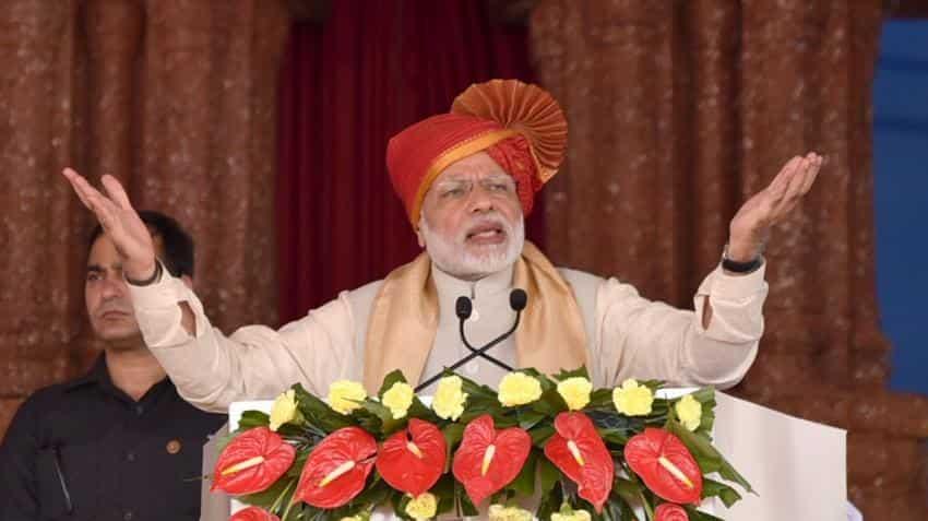 PM Modi warns of tough action against dishonest, announces sops