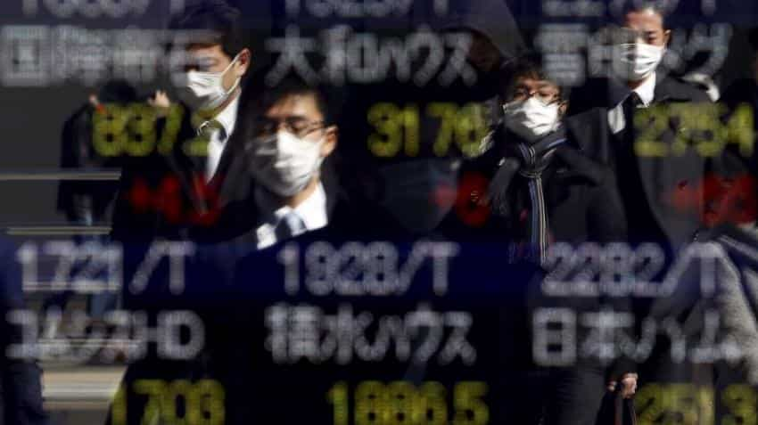 Asian shares off 1 1/2-year high, Trump's yuan comment in focus