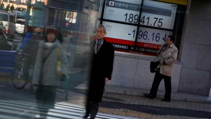 Asian shares edge up, await Trump's policy speech