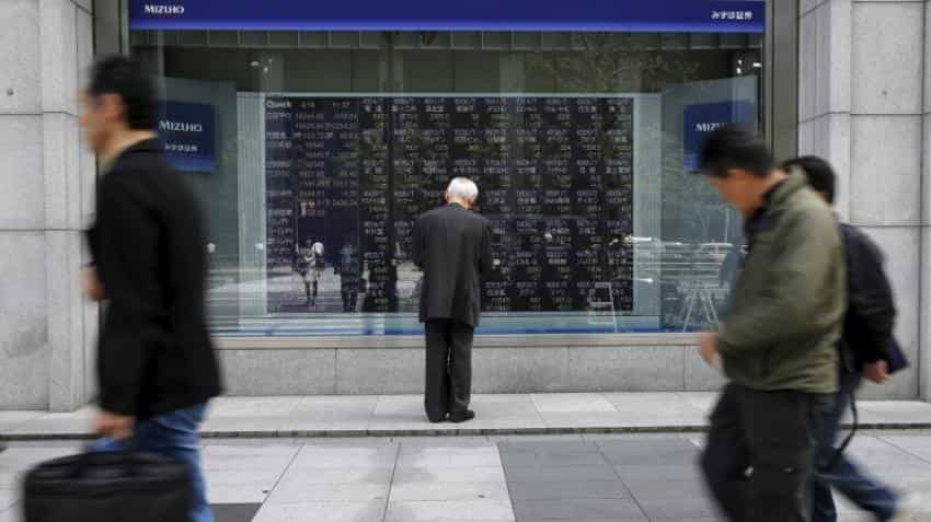 Asia shares off to cautious start as Fed rate hike looms