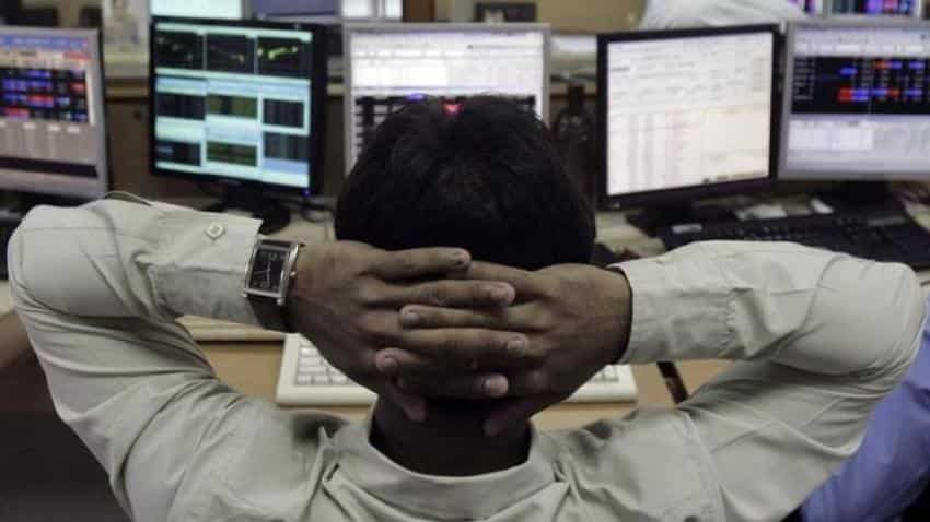 Sensex, Nifty open flat as investors remain cautious ahead of US Fed announcements