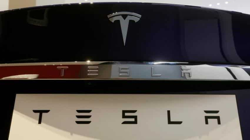 Tesla to raise about $1.15 billion in stock, notes; Musk to buy shares