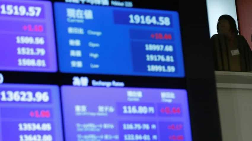 Asia stocks set to end week higher, dollar slides after Fed