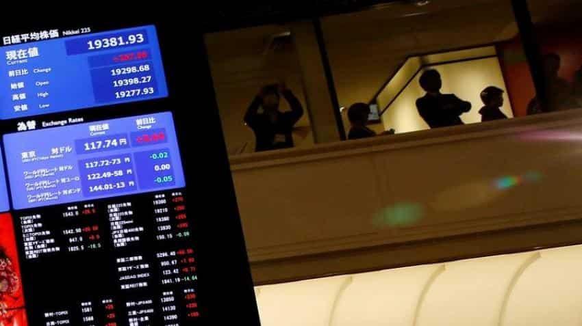 Asian shares near 15-month high, dollar soft on less hawkish Fed
