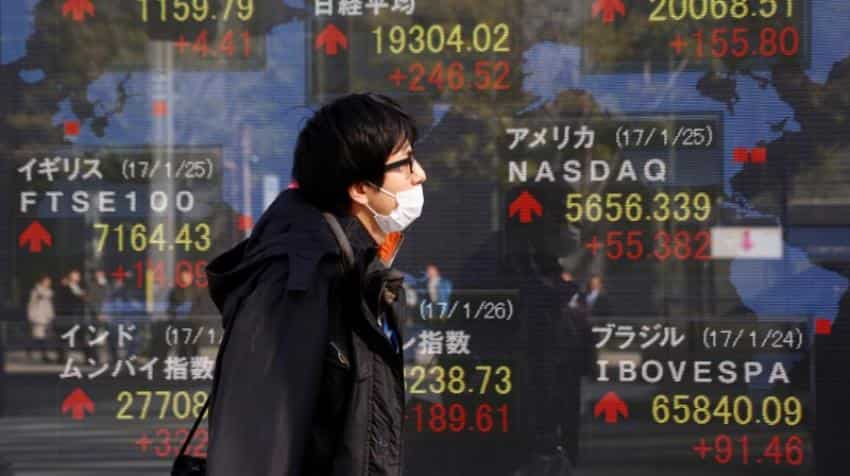Asian stocks pull back on fresh doubts about Trump policies