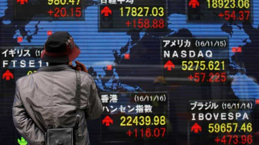 Asia stocks ride global momentum, dollar up on June Fed rate hike bets