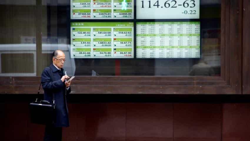 Asian stocks retreat, dollar holds gains on hawkish Fed statement