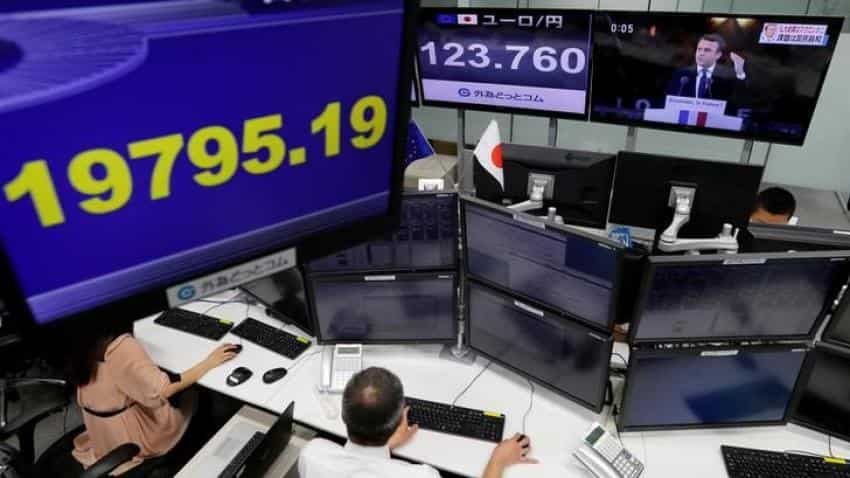 Asia stocks mixed, but Trump's troubles weigh