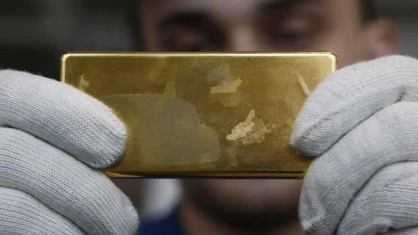 Gold holds near five-week highs, but potential U.S. rate hike drags