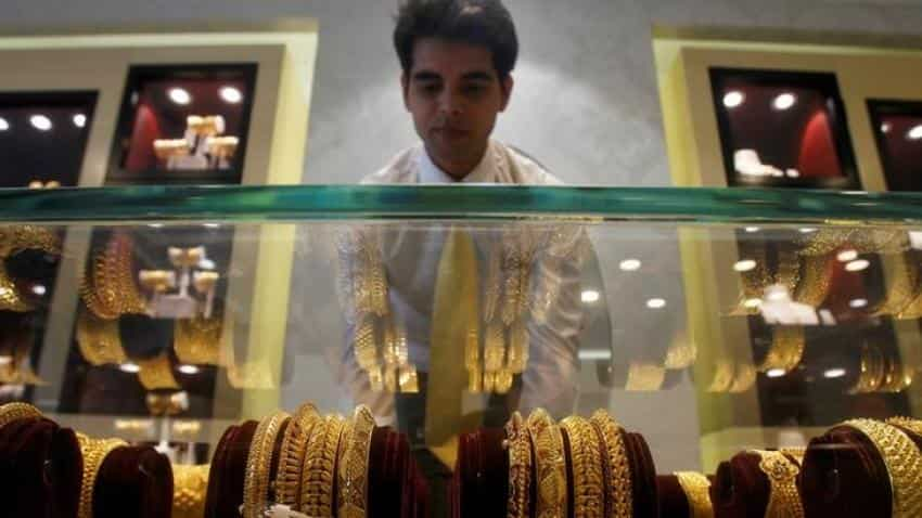 Gold slips as U.S. data lifts dollar, boosts rate hike prospects