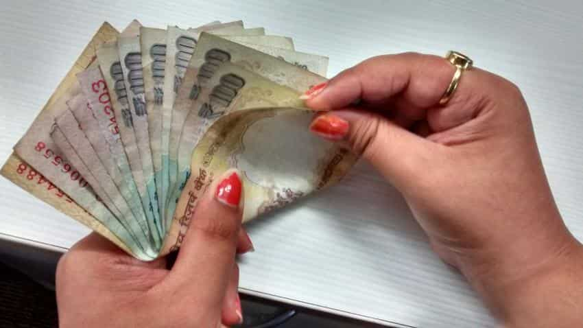 Rupee dips further by 8 paise against dollar ahead of RBI policy