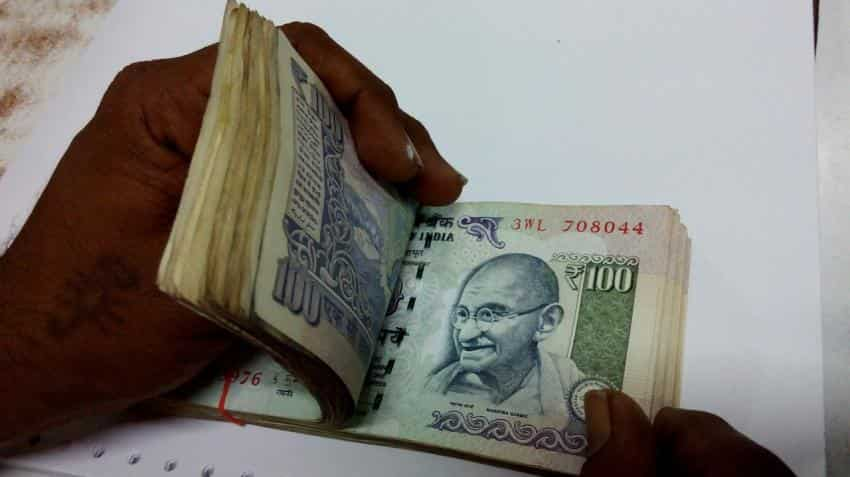Rupee climbs 11 paise against the dollar with Indian markets opening higher