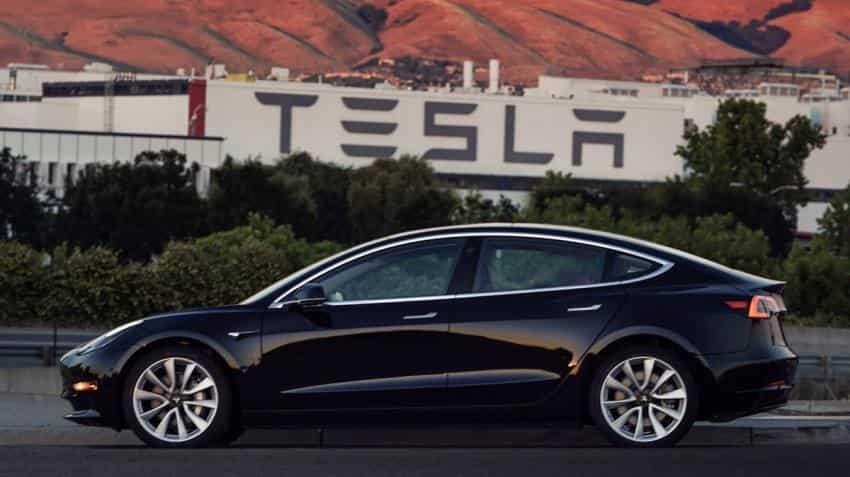Tesla provides first look at cheaper Model 3 sedan