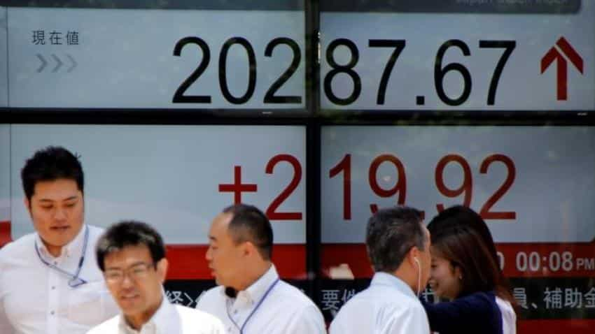 Asian shares dip on profit-taking after Dow hits 22,000