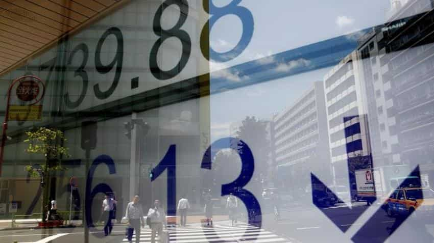 Asian markets wobble as investors await US Fed meeting for rate clues