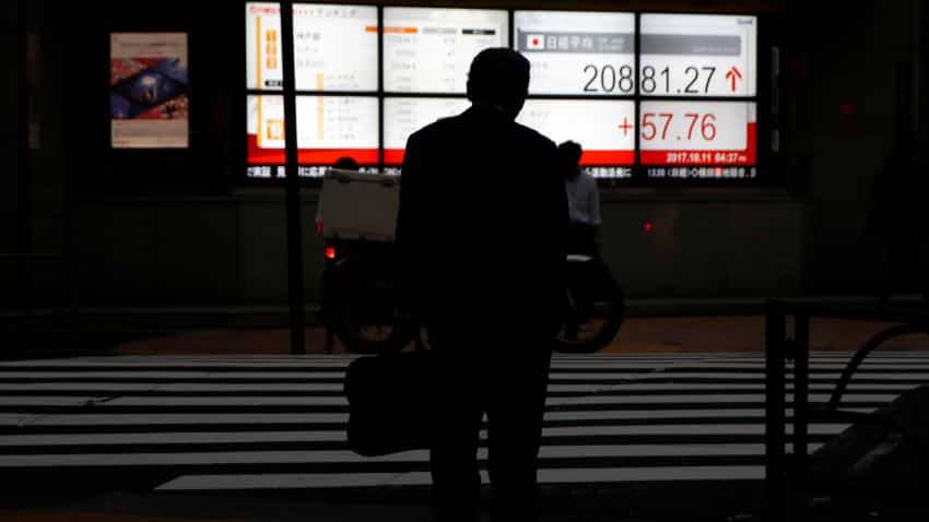Asian markets firm to near 10-year high ahead of US, China economic data