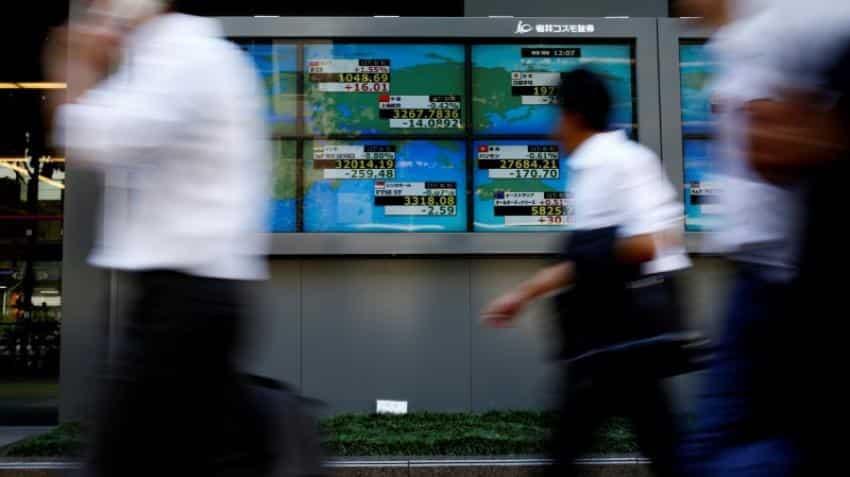 Global Markets: Asian shares gain as earnings, tax debate help U.S. stocks