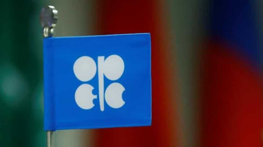 US oil dips on increased drilling, but OPEC cuts support global markets