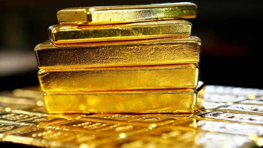 Gold holds near one-week low as stronger US economy data weighs