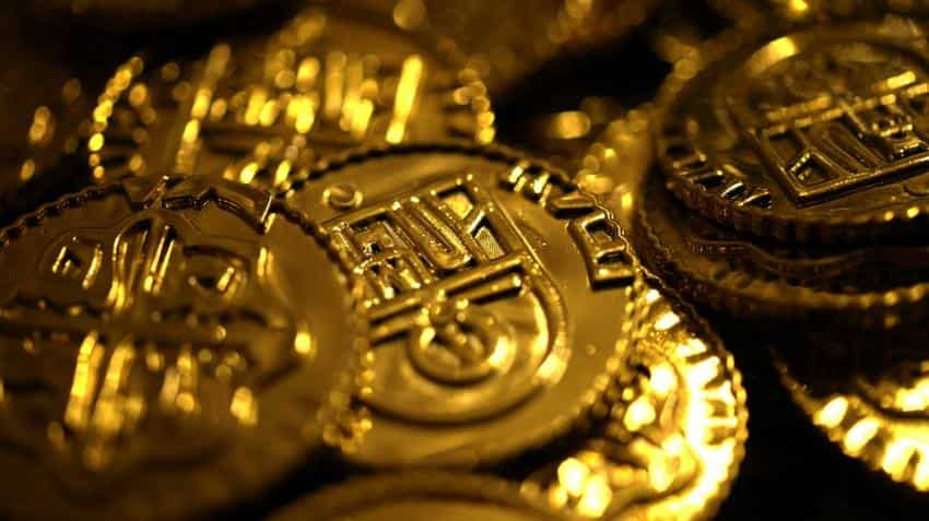Gold briefly jumps 1.2% as Flynn probe roils markets