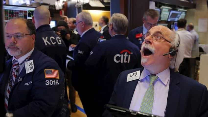 Global Markets: Dollar gains on U.S. tax cut progress; Asian shares listless