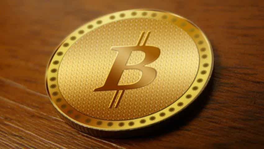 Bitcoin hits record high of nearly $11,800 after futures lift