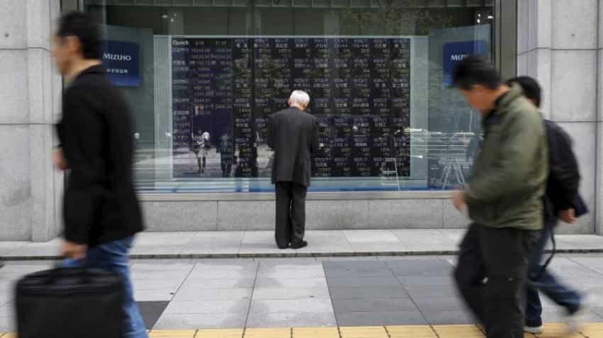 Asian shares subdued as tech blues offset U.S. tax cut hopes