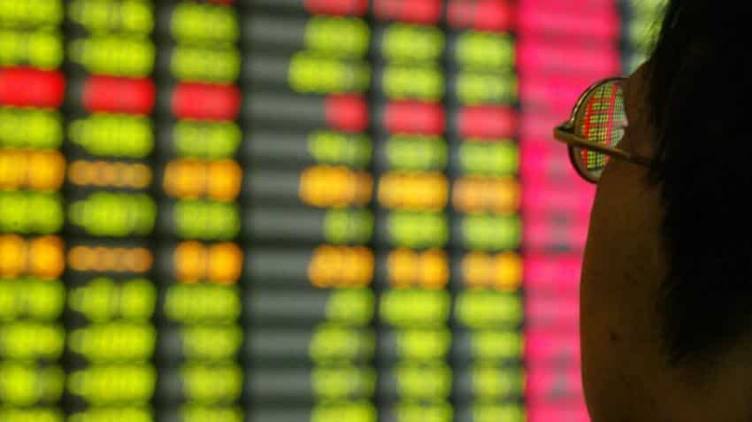 Asia stocks pressured by Wall Street losses, dollar sags