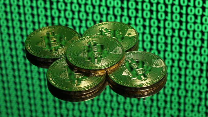 Bitcoin futures make firm debut, dollar holds gains ahead of Fed meet