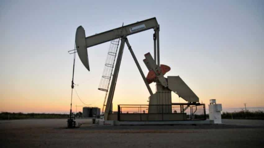 Oil gains on pipeline outage tempered by robust U.S. output