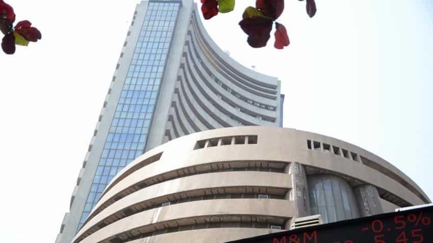 Sensex ends in red; RCom closes up 35%