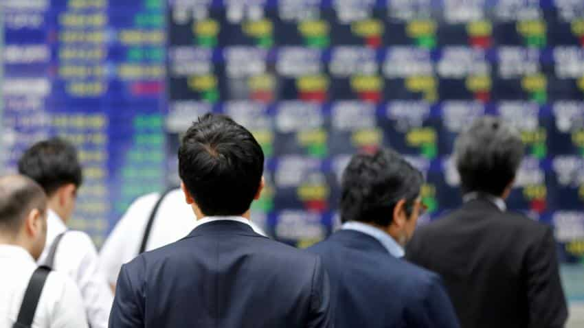 Asia stocks subdued as US tax cuts belt bonds