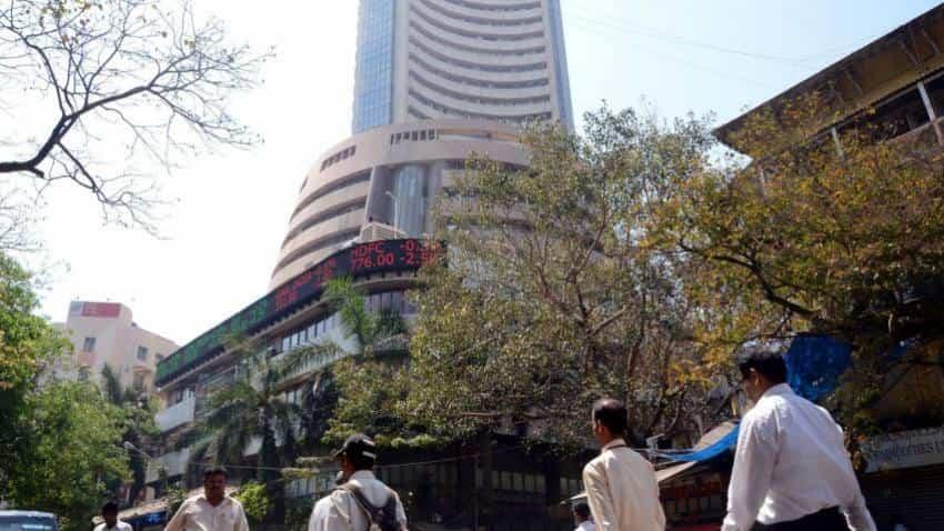 Sensex, Nifty end flat in choppy trade; auto, banks slip