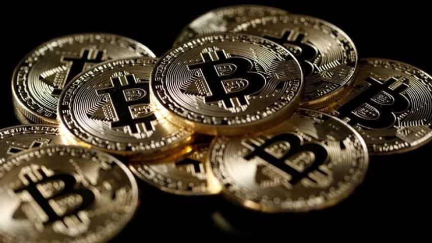 Bitcoin slips below $14,000, down 30% from record peak