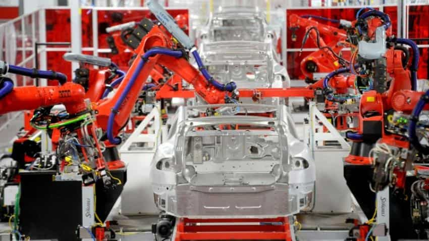 Tesla pushes back Model 3 production target again, despite progress
