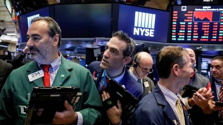 Global stocks records tumble, oil at highest since 2015